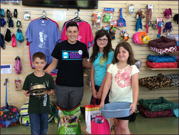 Sophia (birthday girl yellow shirt), Isabelle and Rafael donating